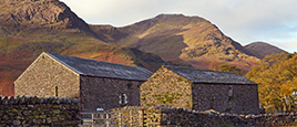Barns with the Lakeland fells behind
