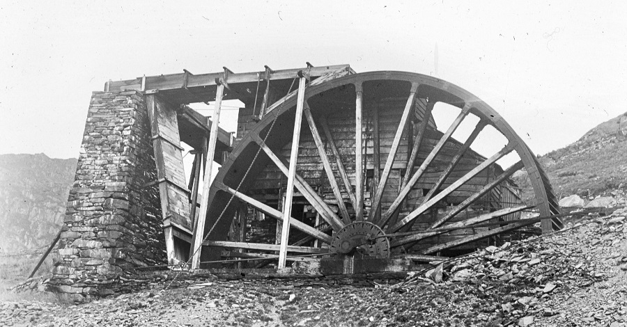 historic imagery of the old engine house waterwheel at Coniston Coppermine, sourced by the Ruskin Museum.