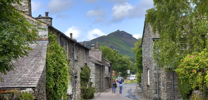 A small village with beautiful fells in the background.