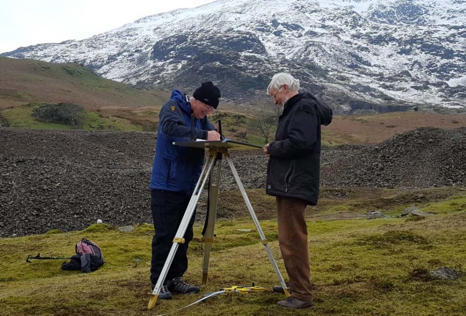 Volunteers surveying at Low Bonsor Mill, Coniston