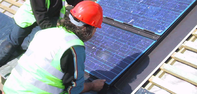 Workmen installing solar panels copyright Sundog Ltd