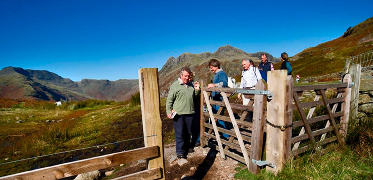 Walkers opening gate in the Langdale valley copyright Charlie Hedley