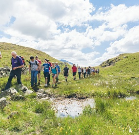 a guided walk group exploring Legburthwaite in the Lake District last summer.