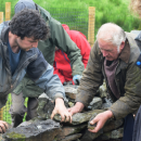 Lake District National Park Volunteers help fix a wall