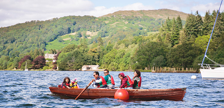 Family in a rowing boat on Windermere
