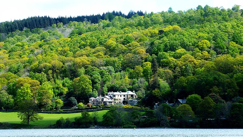 Brantwood house amongst woodland on the shore of Coniston Water
