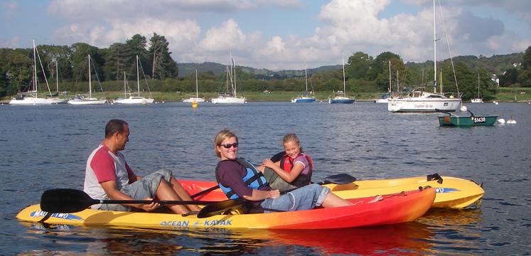 Family canoeing on Windermere copyright Windermere Canoe and Kayak