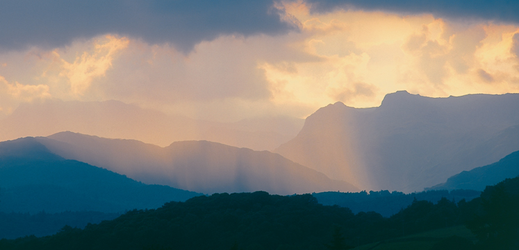 Shafts of sunlight over the Langdale Pikes copyright Val Corbett