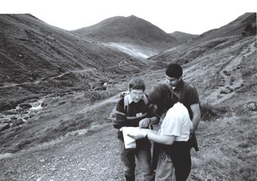 Ranger helping walkers above Greenside Mines