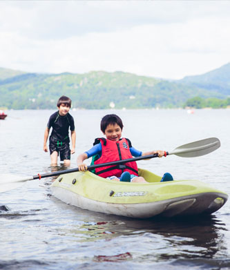 Child on a kayak on Lake Windermere