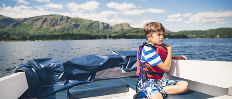 Child on a motor boat on Coniston Water