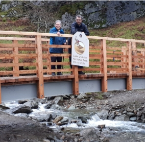 Vivienne Rees, Chair of Grasmere Village Society with David Switzer, LDNP area ranger for the Central and South East at Greehead Gill Bridge, Grasmere.