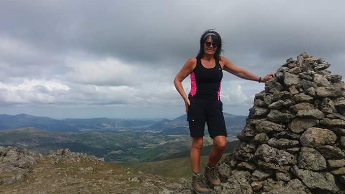 Woman on a Lake District fell summit.