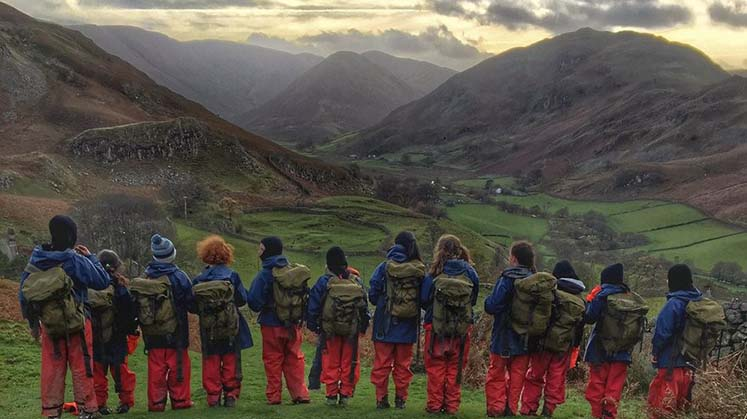 Children looking down from Hallin Fell