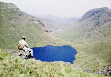Taking in the view above Grisedale Tarn