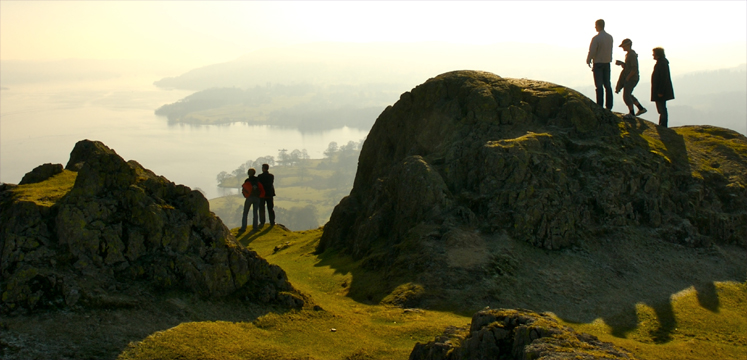 Walkers on Loughrigg fell overlooking Windermere copyright John Morrison