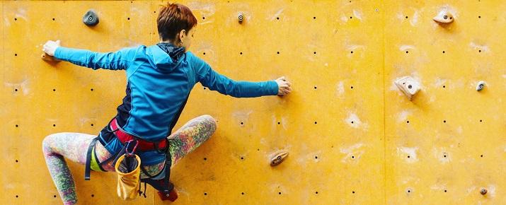 A lady climbing the wall