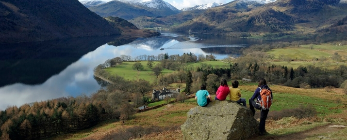 FAmily looking out and admiring the sunning landscape over Ullswater