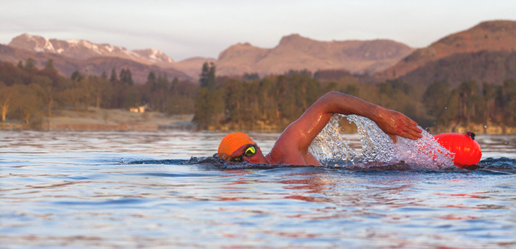 Open water swimmer with hat and towfloat copyright Chillswim