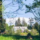 Brockhole house through the gardens