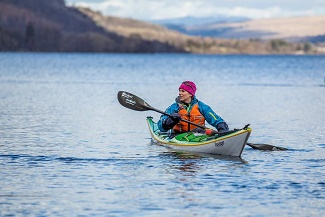 Woman kayaking on Lake Windermere.