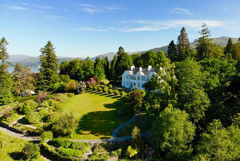 Looking down over Brockhole house and the Mawson designed gardens with views over Windermere and the Langdales in the distance.