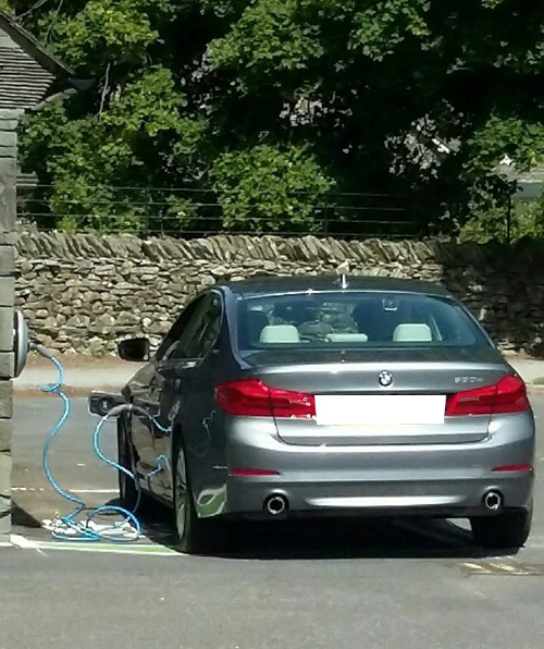 Electric car charging in a Lake District car park
