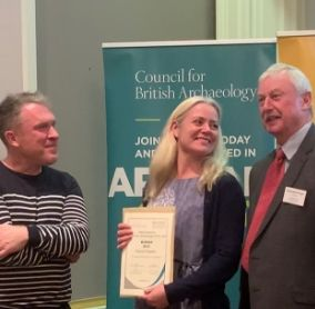 the Lake District National Park's Eleanor Kingston receiving the Council for British Archaeology's Community Award from Richard Osgood, Archaeologist and Charles Micklewright, Trustee of the Marsh Christian Trust.
