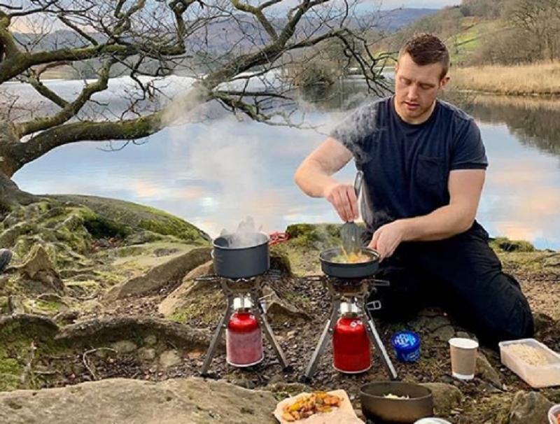 Harrison Ward making food outdoors.