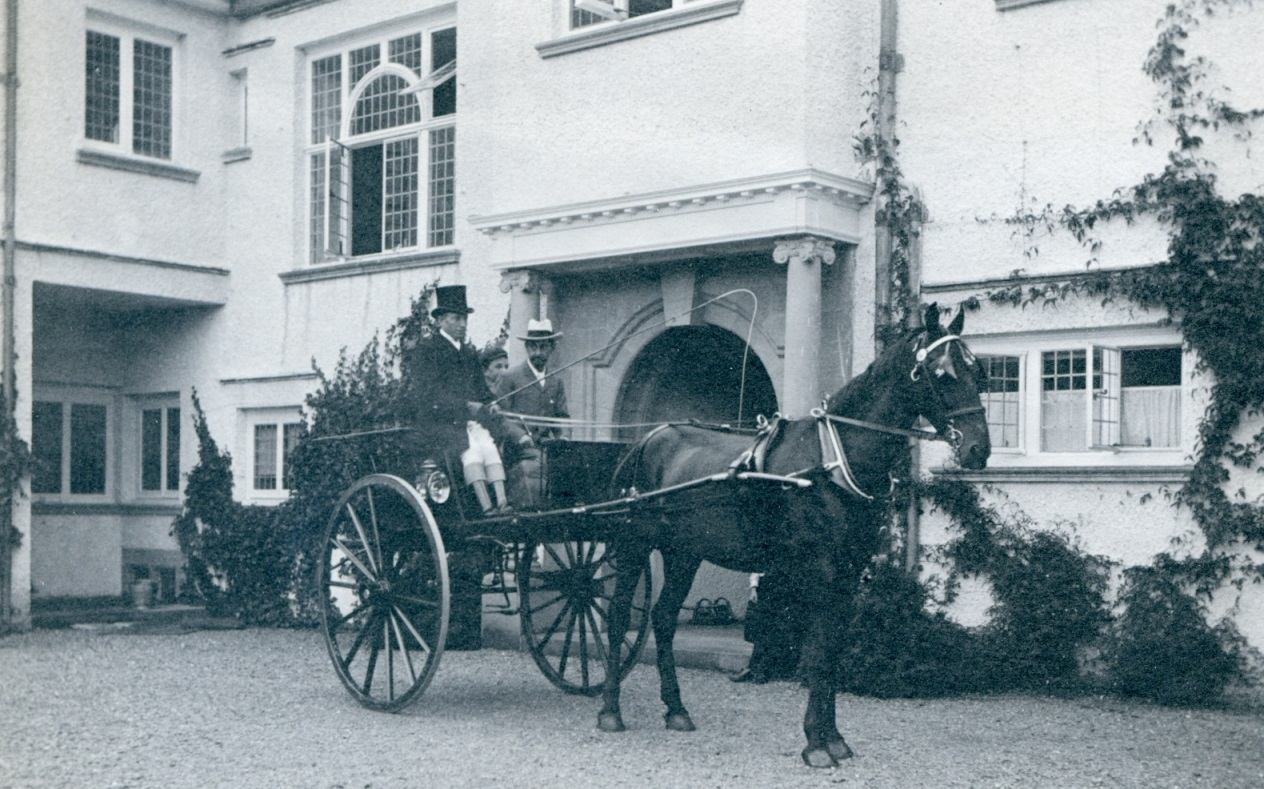 A member of the Gaddum family outside the original Brockhole House in the early 1900s.