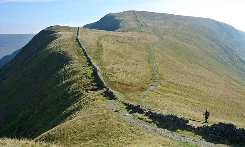 A walker on a Roman road in the high fells, High Street, Lake District