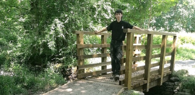 Jed Porter standing on a bridge he mended.