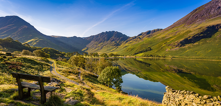 Buttermere lake shore with a wooden bench