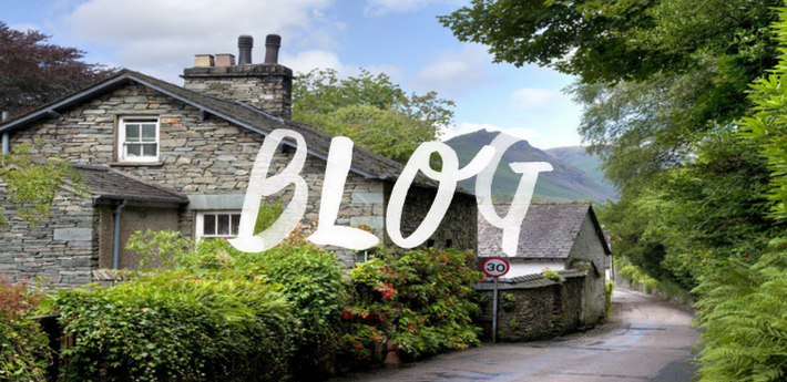 A dry stone house next to a quiet road in the Lake District