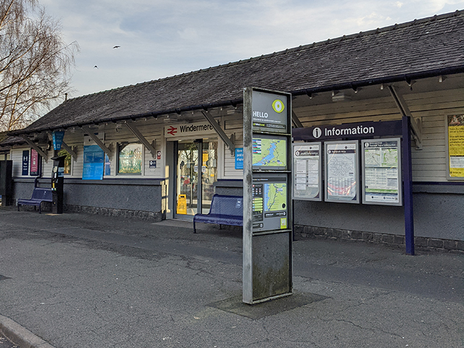 An information panel and map outside Windermere Railway Station.