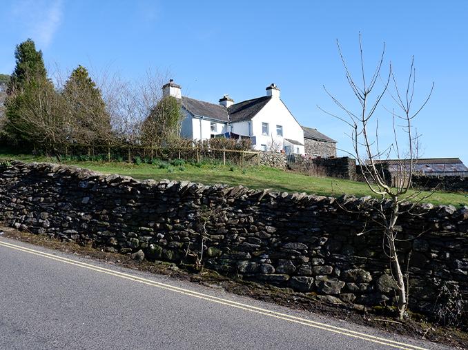 A white farmhouse cottage.