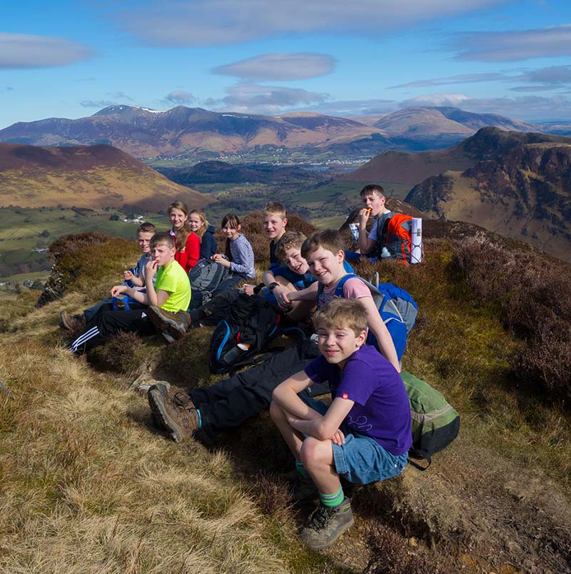 School children on a fell summit in the Lake District.