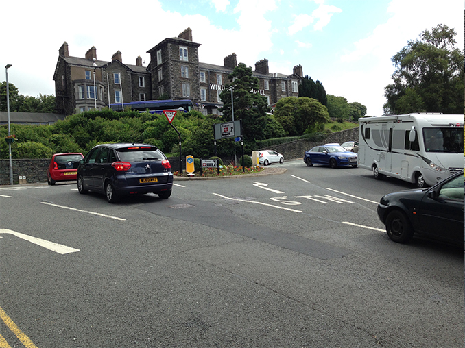 A road junction with lots of traffic.