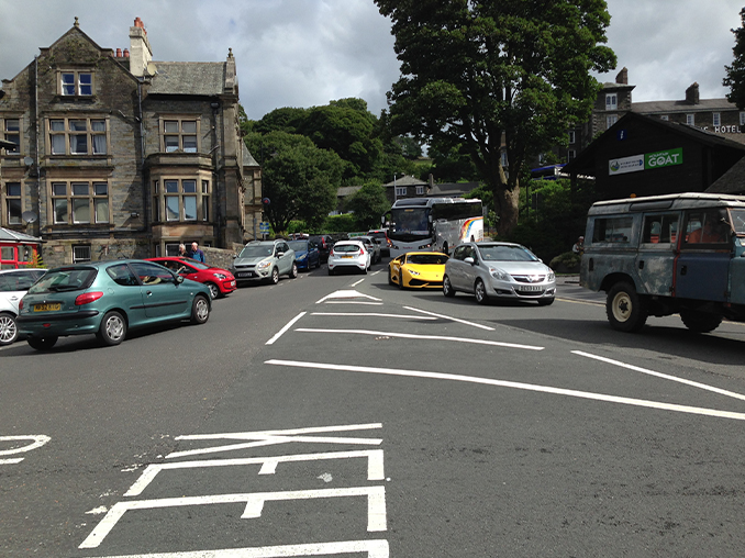 Cars driving at a busy road junction