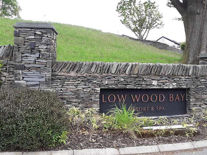 Stone wall with sign for Low Wood Bay Resort and Spa