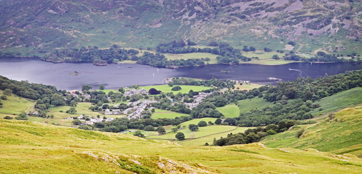 Ullswater in the distance with lovely green grass