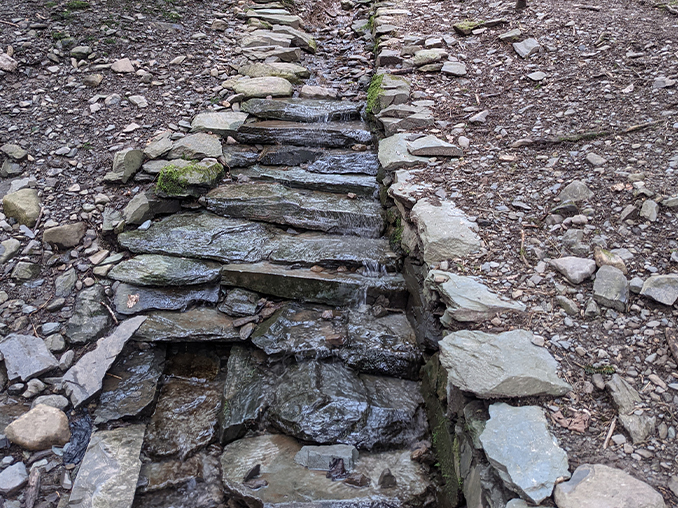A stone laid drainage channel.