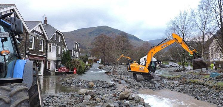 Diggers repairing flood damage in Glenridding