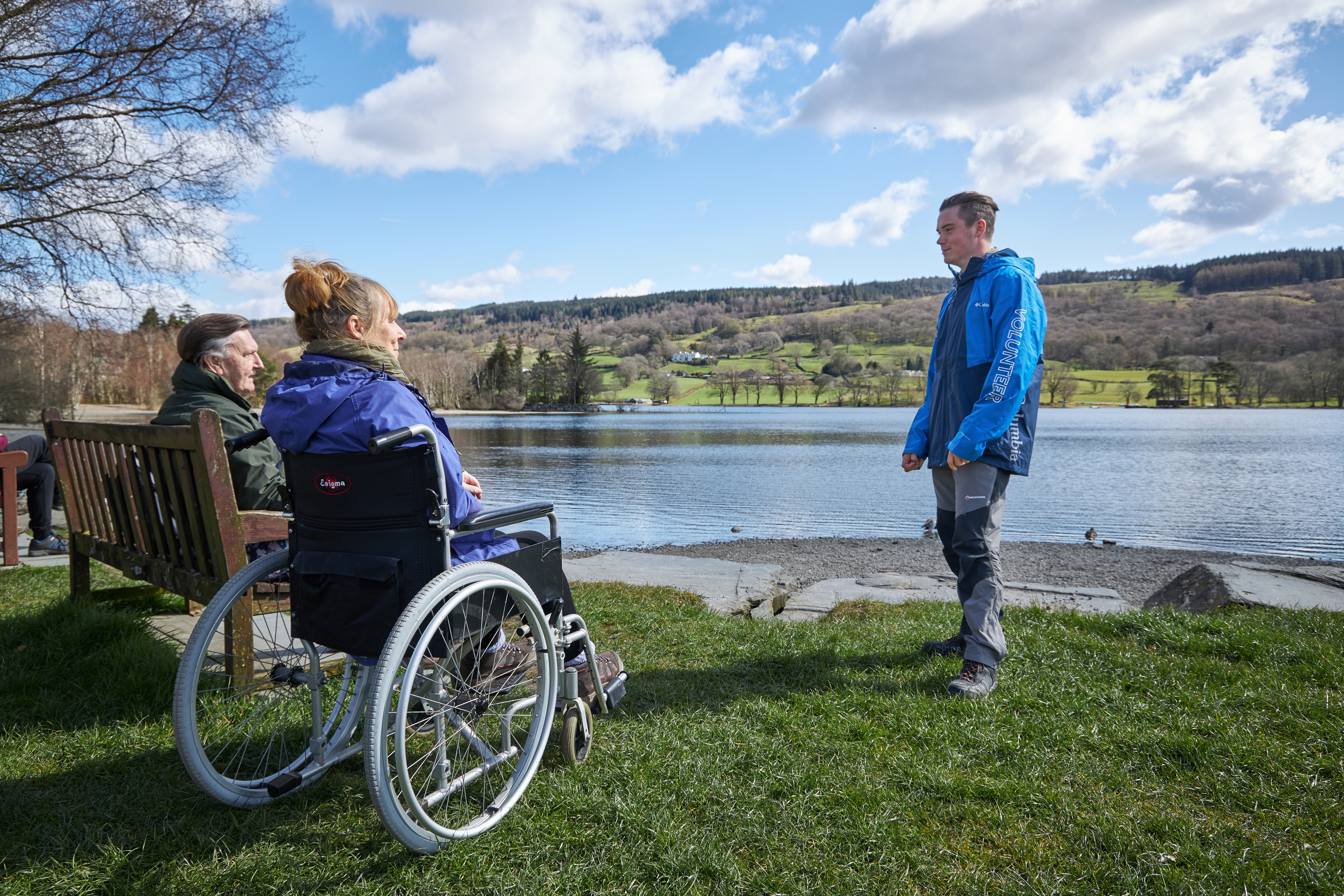 Wheelchair user by a lake shore - Adrian Naik