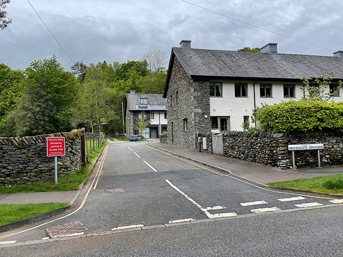 Road junction with dry stone walls.