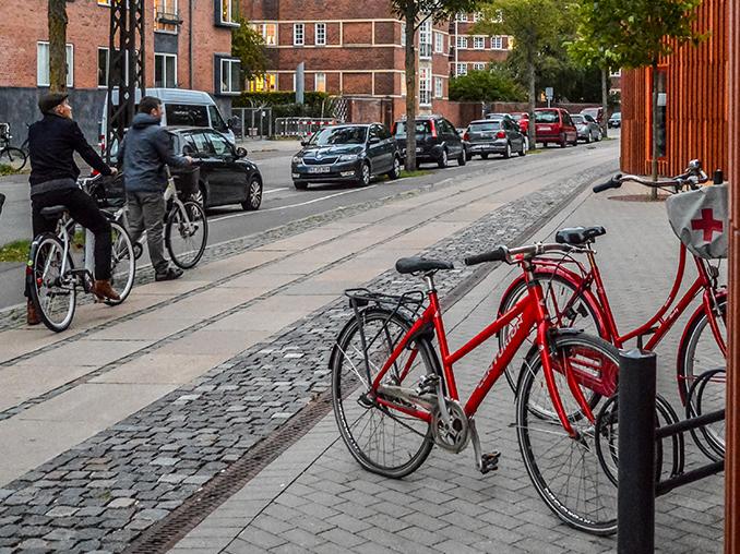 Bikes parked on a cobbled street in Copenhagen.