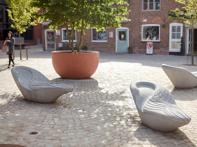 Symbolic geese-like seats on a city street
