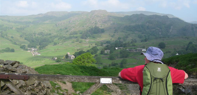 Walker taking in the Kentmere valley view copyright Helen Reynolds